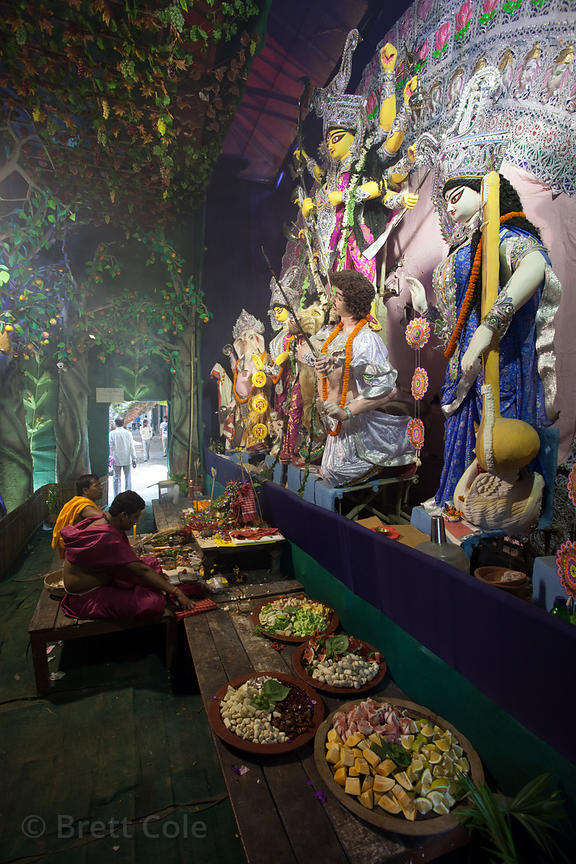 Hindus perform puja (prayers) inside a Durga Puja pandal near Sovabazar, Kolkata, India.