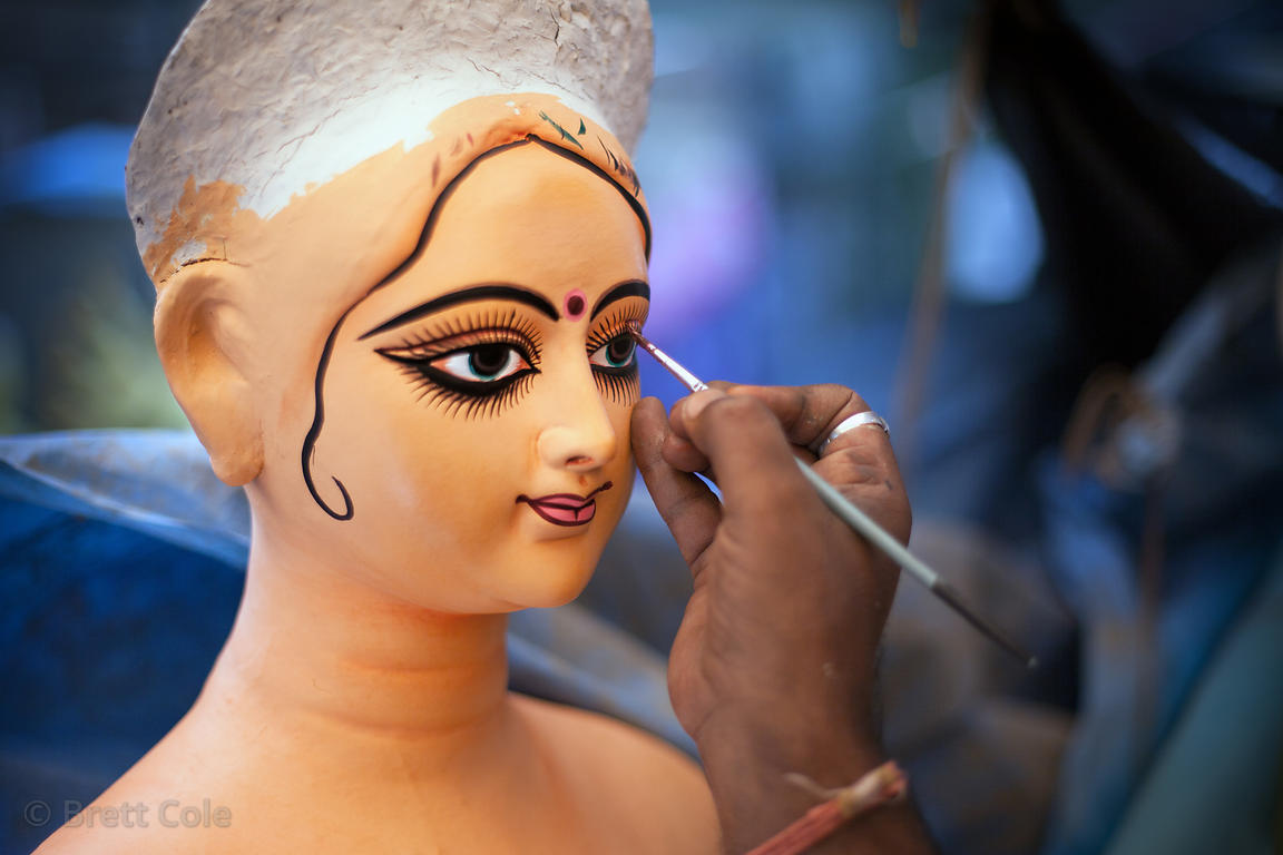 Eyes are painted on a Durga Puja idol at a workshop in Kumartoli (Potter's Town), Kolkata, India. The idols are said to come ...