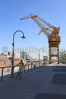 Puerto Madero docklands regeneration in Buenos Aires, Argentina with crane and girl roller-blading