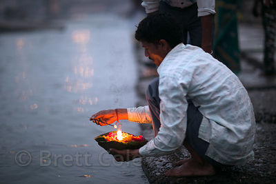 A man launches a diya on the Ganges River, Haridwar, India