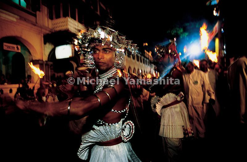 The Esala Perahera procession is led by thousands of dancers wearing medieval court dress and traditional costumes.