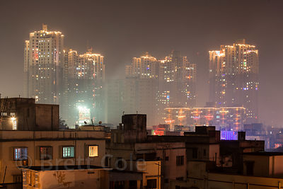 Night view of 35-story apartment buildings near South City Mall in Lake Gardens, Kolkata, India. The buildings are the talles...