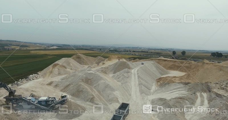 Loaders Excavators and Dump Trucks at a Highway Construction Project Israel