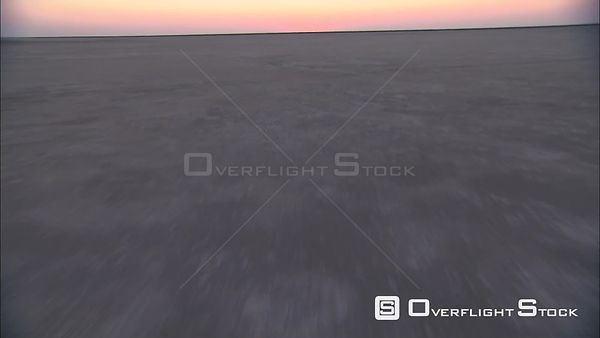 Aerial shot of three people walking on the Makgadikgadi Pan Okavango Delta Botswana