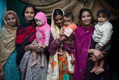 Three mothers and their toddlers in Jodhpur, Rajasthan, India