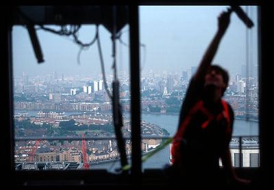 Window cleaner at Canary Wharf Tower in London