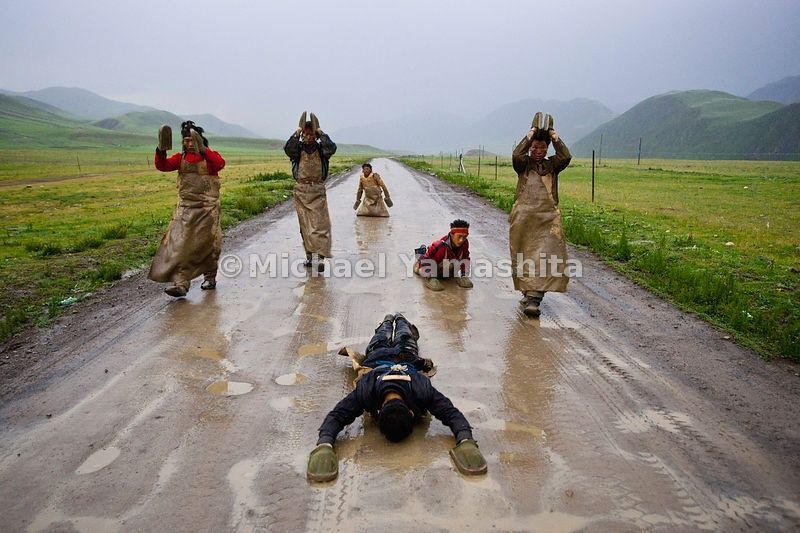 Devout pilgrims proceed at a snail's pace performing the Chak Tsal, the Tibetan name for ritual prostration. Their journey fr...
