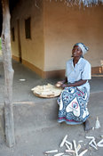 Woman preparing corn, lake Niassa, Mozambique