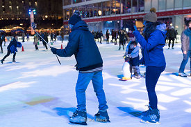A couple takes a selfie at the Bryant Park Winter Village in Manhattan, New York City
