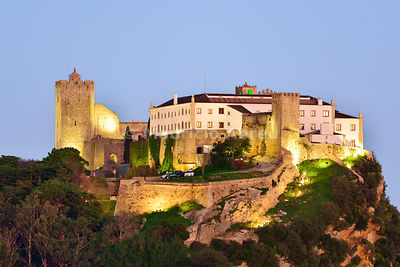The 12th century castle of Palmela and the Pousada (Hotel) at twilight. Arrábida Nature Park. Portugal