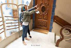Tourists taking selfies at Casa Batlló, an architectural masterpiece by Antoni Gaudí in Barcelona, Spain.