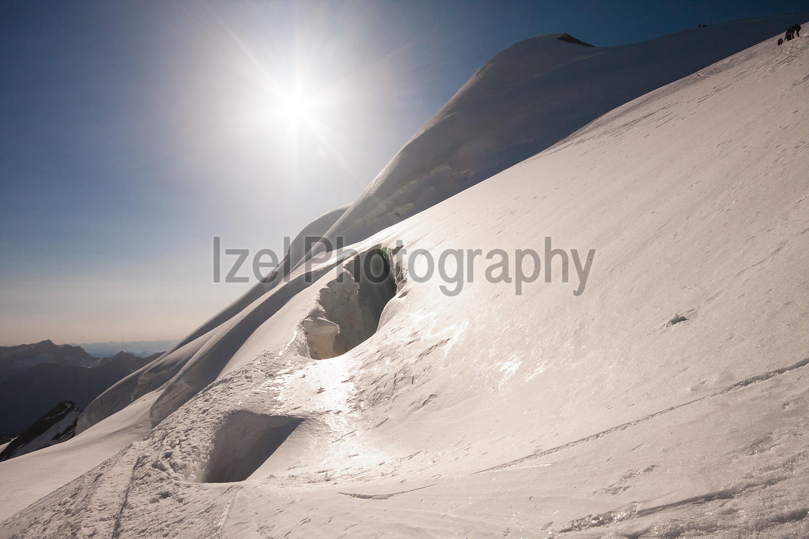A snow bridge over a large crevasse on route to Feechopf Ridge. Saas Fee Switzerland.