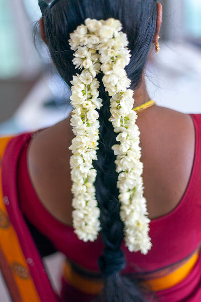 Jasmine flowers in the hair of a shop assistant in the Oh Lala boutique in Pondicherry, India