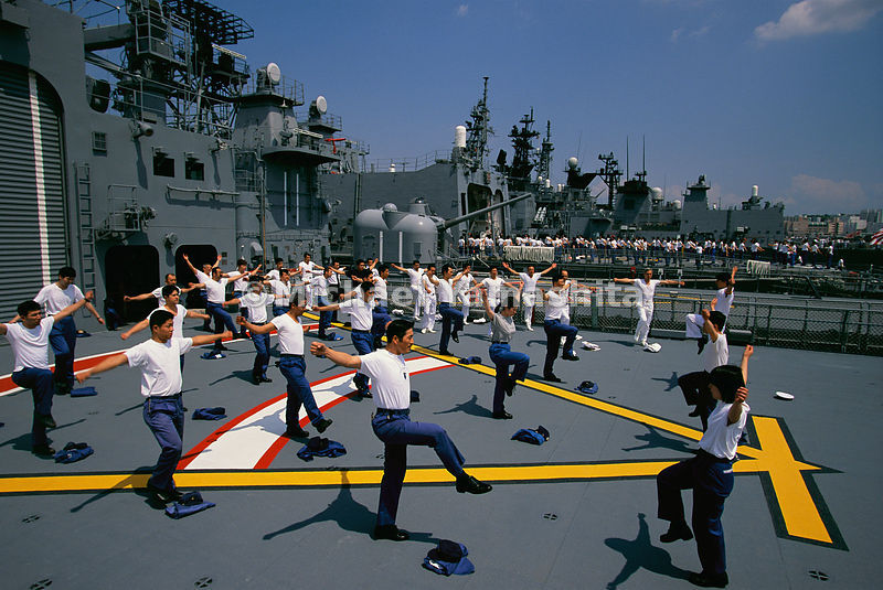 Japan's Self-Defence-Force crew-members taking their morning exercises on the destroyer Hatsuyuki.