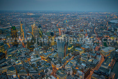 Aerial view over the City at night looking North, London