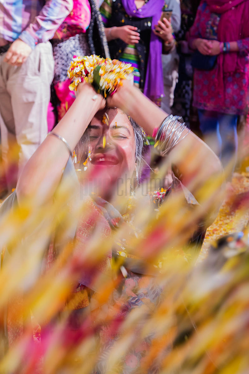 Woman Throwing Flower Petals at Holi Celebration