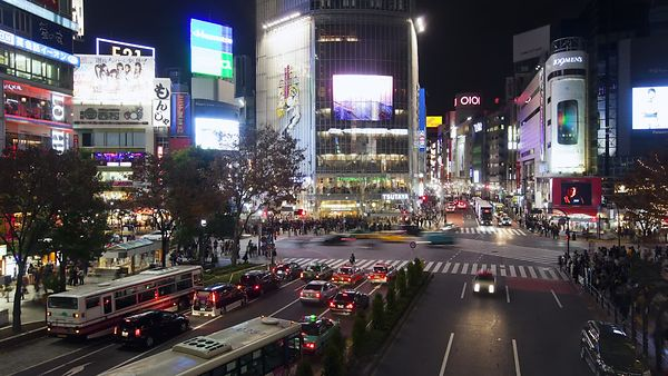 Wide Shot: Throngs Of Pedestrians At Shibuya Crossing