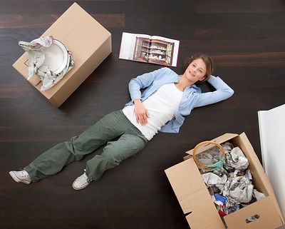 Woman laying on floor with boxes
