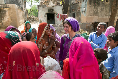 A female tourist from the UK talks to ladies in remote Nadi village, Rajasthan, India. Interesting to see how much more excit...