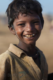 Poor but happy boy in the desert near Pushkar, Rajasthan, India