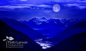 Moon Rising Over Alaskan Mountains