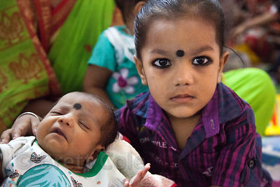 A boy and his baby brother at the Swastha Kendra Clinic operated by the NGO Calcutta Kids (calcuttakids.org) in Howrah, India