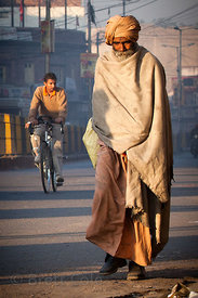 Sadhus (holy men) walking at sunrise, Jodhpur, Rajasthan, India