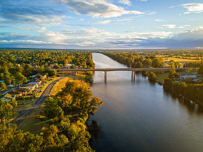 Scenic views of the Nepean River Penrith, in the foreground the M4 bridge crossing. Australia
