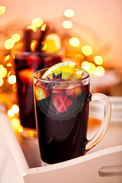 Two glasses of mulled wine on xmas background