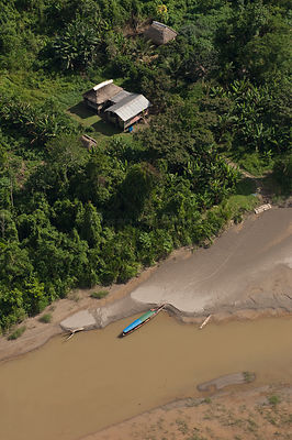 Quichua Indian houses on Napo River seen from the air. Near Yasuni National Park, Ecuador, June 2007.