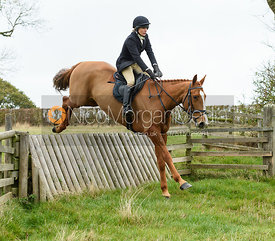 Hilary Butler jumping a hunt jump near Peake's. The Cottesmore Hunt at Somerby