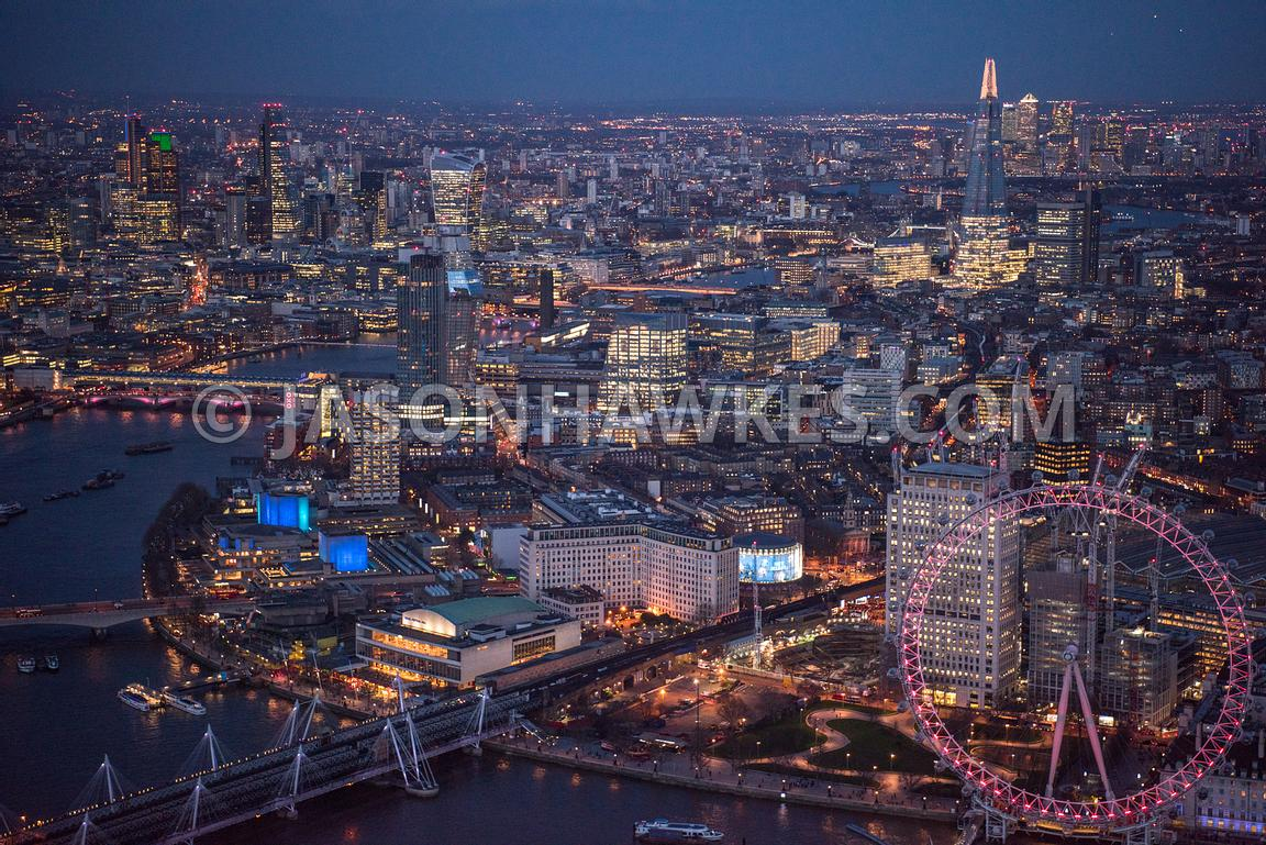 Aerial view, SouthBank, London. Jubilee Gardens (London), Kings College London (Waterloo Campus) (London), London Eye, London IMAX Cinema, London Television Centre, Millenium Wheel, night, One Blackfriars, river thames, Royal Festival Hall, Royal National Theatre, Shell Centre, South Bank, Southbank, waterloo