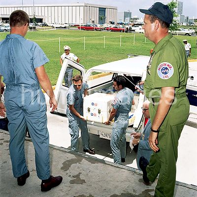 (25 July 1969) --- The first Apollo 11 sample return container, with lunar surface material inside, is unloaded at the Lunar ...