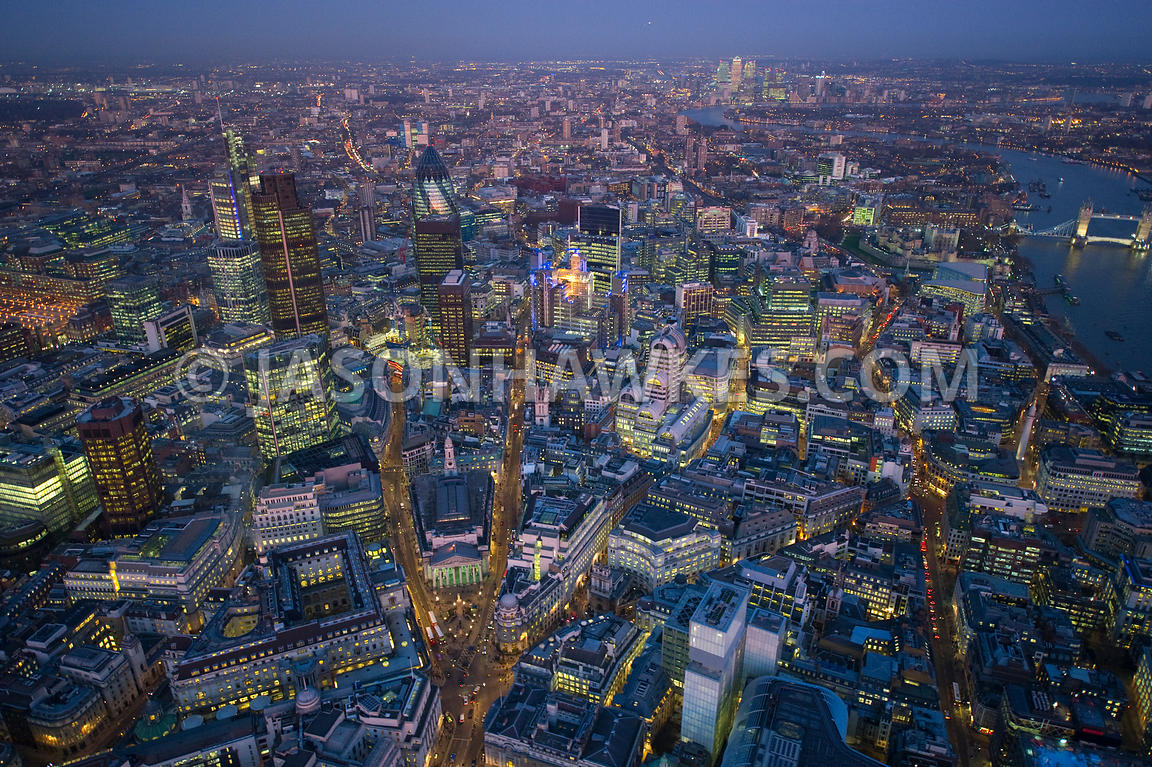 Aerial view over the City of London at night