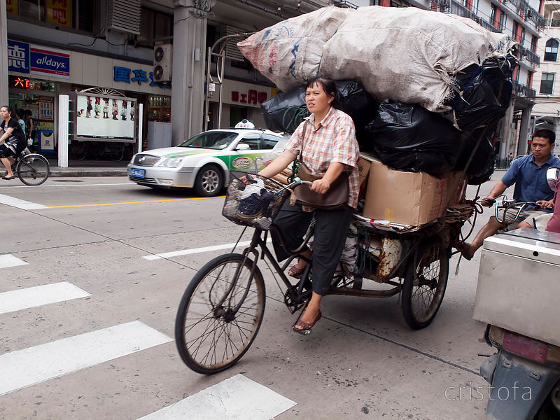 a large load on a pedal tricycle