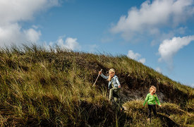 Danish girls playing in the dunes in Thy