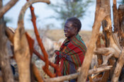 Karamojong woman in the cattle kraal in the village, northern Uganda
