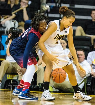 Robert Morris' Jolie Olingrnde (44) guards Iowa's Chase Coley (4) during the first half of play at Carver-Hawkeye Arena in Io...