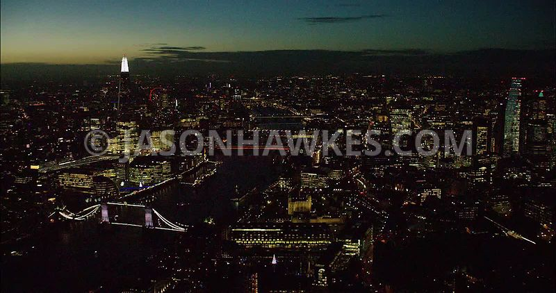 London night aerial footage, The Shard and City of London at night.