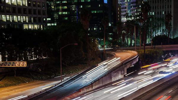 Medium Shot: Panning Rush Hour Ramps & Throughways Through The Heart Of Downtown L.A.