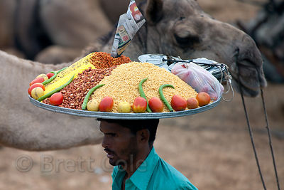 Veggie snack vendor and camels in Pushkar, Rajasthan, India