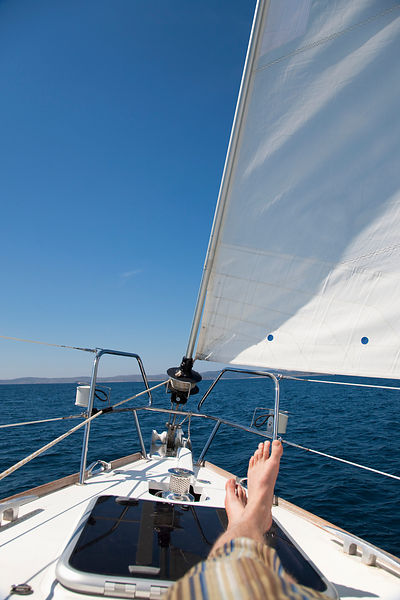 Croatia, Zadar, Young man relaxing on sail boat