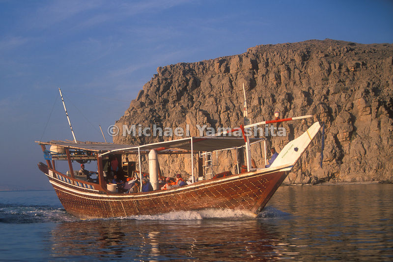 A Khasab Tour boat in the waters off the Musandam Peninsula, Oman.