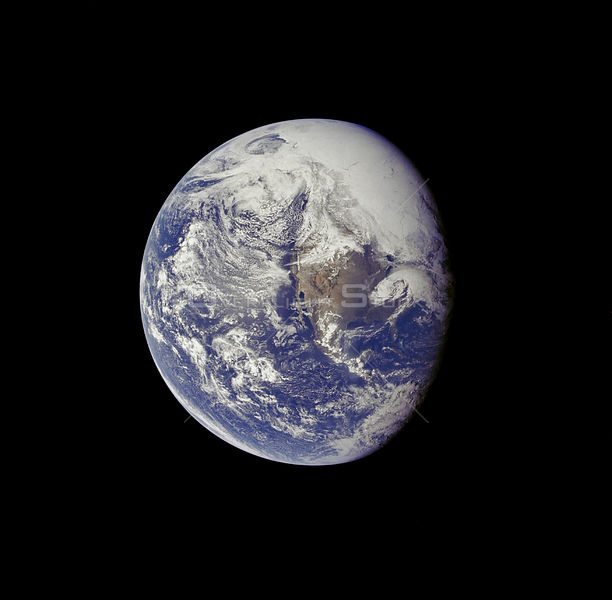 EARTH -- 16 Apr 1972 -- A view of the Earth photographed about one and one-half hours after trans-lunar injection.