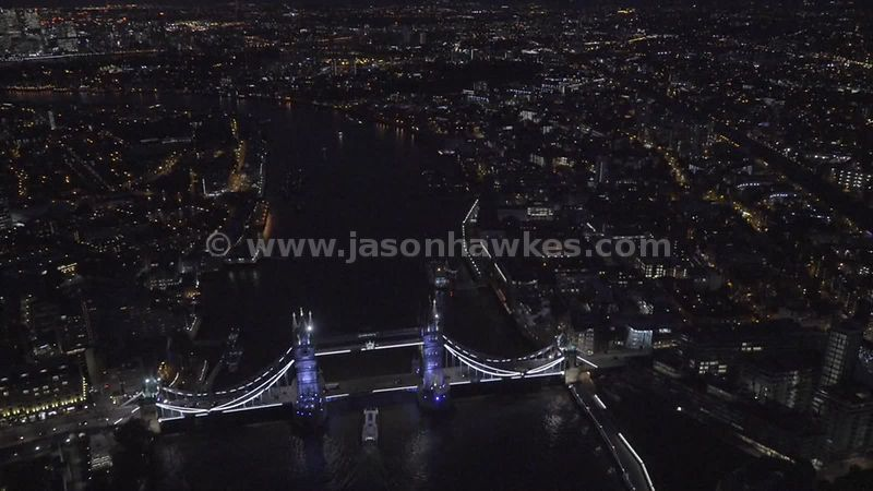 Aerial footage of Tower Bridge at night