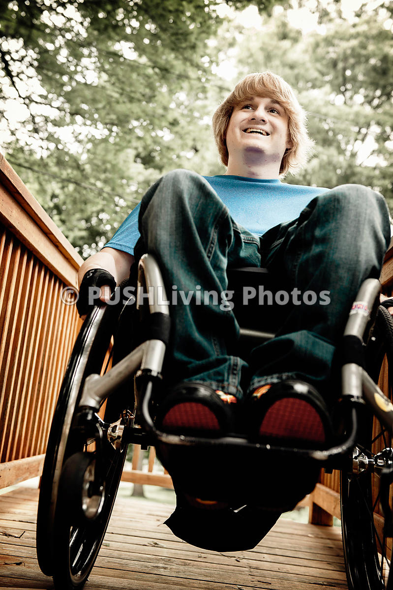 Young man on a wheelchair ramp