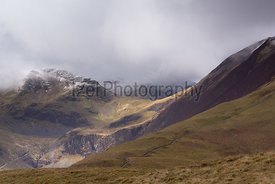 Crag Hill and Grasmoor in the cloud in the distance from Sleet How leading to Grisedale Pike.