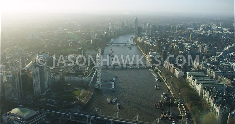 London Aerial footage, London Eye with River Thames towards Westminster Bridge.