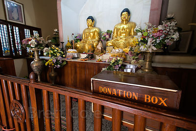Gold Buddha statues Mulagandhakuti Vihara temple in Sarnath, India.