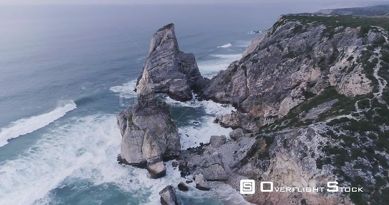 Aerial drone flying over rocky cliffs on the beautiful coast of Portugal